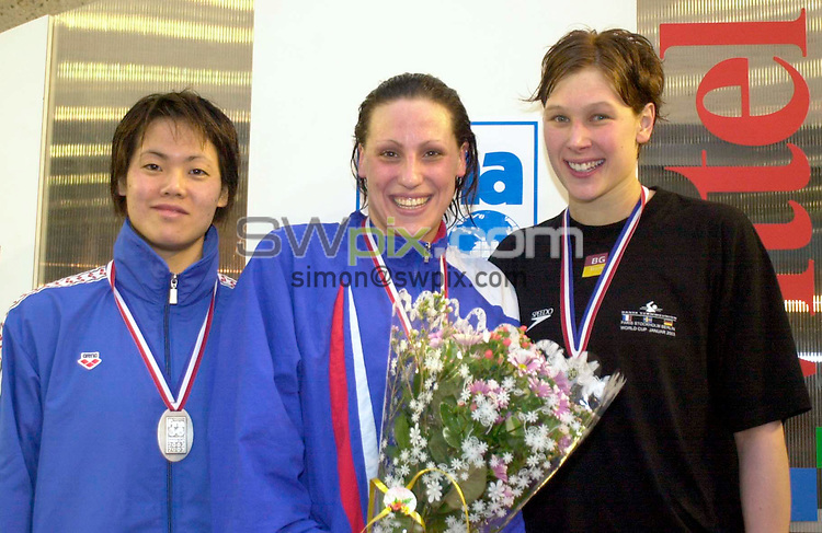 Pix:Ben Duffy/SWpix.com. FINA World Cup Swimming-Paris, Piscine George Vallerey....18/01/2003...COPYRIGHT PICTURE>>SIMONWILKINSON>>01943 436649>>..Great Britains Sarah Price receives her gold medal after winning the womens 100m backstroke