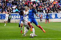 Harrison, NJ - Sunday March 04, 2018: Taylor Smith, Amel Majri during a 2018 SheBelieves Cup match match between the women's national teams of the United States (USA) and France (FRA) at Red Bull Arena.