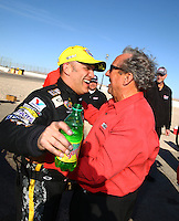 Mar 30, 2014; Las Vegas, NV, USA; NHRA top fuel driver Tony Schumacher (left) celebrates with father Don Schumacher after winning the Summitracing.com Nationals at The Strip at Las Vegas Motor Speedway. Mandatory Credit: Mark J. Rebilas-