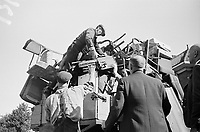 Photo from the NIOD's Huizinga collection. Residents from the Marlot district in The Hague, who have to evacuate due to launches of V2 rockets, load their contents on a cart (September 11/12, 1944).
