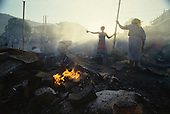 Port-au-Prince, Haiti.November 23, 1987..To disrupt the upcoming elections the Marche Salomon is burnt down in the night by suspected ton-ton-macoutes. The elections were to be held on November 29th, the first attempt at a democratic election in Haiti. It was unsuccessful as 34 people were killed at a polling station and elections were moved up to February 1988...Leslie François Manigat won the election with many political parties boycotting. He had military backing but once in office he sought greater control over the military in an effort, to fight corruption. Manigat's government was overthrown by General Henri Namphy within months.