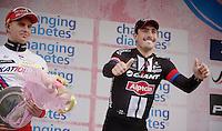 A very happy race winner  John Degenkolb (DEU/Giant-Alpecin) on the podium next to the previous winner Alexander Kristoff (NOR/Katusha)<br /> <br /> 106th Milano - San Remo 2015