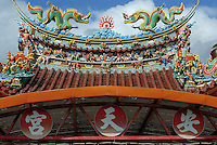 Intricate rooftop detail on a temple on the east coast, just north of Taitung City, Taiwan. Taitung, and the coastal strip north of it up to Chenggong, has been seeing a big increase in property investment and new construction as people from the capital, Taipei, and some foreign investors, seek to buy holiday and retirement homes in this area of outstanding natural beauty. At the same time, property prices across the board in Taiwan are expected to rise bullishly following a return of the former ruling party - the KMT - to power in March 2008 elections, and their anticipated change of policy to allow Mainland Chinese purchases of Taiwan property..