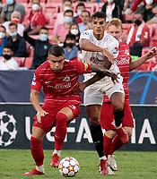 14th September 2021; Sevilla, Spain: UEFA Champions League football, Sevilla FC versus RB Salzburg; Erik Lamela of Sevilla  and Nicolas Seiwald of Salzburg  challenge for the ball