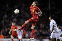 21.02.2013 Liverpool, England. Daniel Agger of Liverpool in action as he lays off a chested ball to Gerrard during the Europa League game between Liverpool and Zenit St Petersburg from Anfield. Liverpool won 3-1 on the night but went out of the competition on away goals.