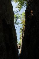 Hanging rock in a crevice at Agawa Bay, Lake Superior.