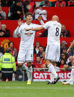 Pictured L-R: Ki Sung Yueng celebrating his goal with team mate Jonjo Shelvey. Saturday 16 August 2014<br /> Re: Premier League Manchester United v Swansea City FC at the Old Trafford, Manchester, UK.