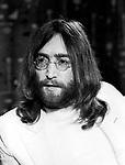 Beatles 1969 John Lennon at Heathrow Airport.© Chris Walter.