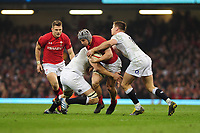 Pictured: Jonathan Davies of Wales is tackled by Joe Launchbury of England during the Guinness six nations match between Wales and England at the Principality Stadium, Cardiff, Wales, UK.<br /> Saturday 23 February 2019