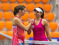 Rotterdam, Netherlands, December 17, 2015,  Topsport Centrum, Lotto NK Tennis, Eva Wacano (R) congratulates Quirine Lemoine (NED) with her win.<br /> Photo: Tennisimages/Henk Koster
