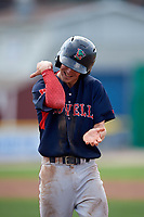 Lowell Spinners shortstop Grant Williams (11) gestures to his teams bullpen after reaching first base on a walk during a game against the Batavia Muckdogs on July 15, 2018 at Dwyer Stadium in Batavia, New York.  Lowell defeated Batavia 6-2.  (Mike Janes/Four Seam Images)