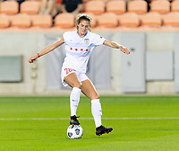 HOUSTON, TX - APRIL 09: Kayla Sharples #28 of the Chicago Red Stars gain control of a loose ball during a game between Chicago Red Stars and Houston Dash at BBVA Stadium on April 09, 2021 in Houston, Texas.