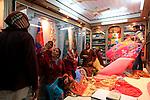 Female customers in a silk shop in Varanasi old town. Varanasi. India