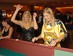 Kristen Malone and Heather Karnowski hit it big at the craps table at the Health Museum Casino Party at the Four Seasons Hotel Saturday Aug. 15, 2009.(Dave Rossman/For the Chronicle)