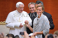 Pope Benedict XVI wears the cup of Italian national team presented by Federica Pellegrini (R) of Italy, twice gold medallist at the World Swimming Championships, during the audience for competitors of the World swimming championships being held in Rome, outside of his summer residence in Castelgandolfo south of Rome on August 1, 2009. In a special audience Pope Benedict XVI met with competitors from the World Swimming Championships.