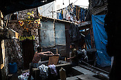 Washermen (locally known as Dhobis) wash clothes at the Laundromat in Dhobighat in India's financial capital, Mumbai, India. The laundry comes from different sections of the society - from hospital to hospitality to garment factories and normal households.