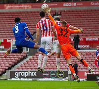 9th January 2021; Bet365 Stadium, Stoke, Staffordshire, England; English FA Cup Football, Carabao Cup, Stoke City versus Leicester City; Goalkeeper Josef Bursik of Stoke City gets a hand to the ball above defender Batth to clear the danger from a cross