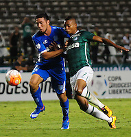 CALI -COLOMBIA-17-03-2016: Harold Preciado (Der) jugador del Deportivo Cali de Colombia disputa el balón con Sergio Vittor  (Izq) jugador de Racing Club de Argentina durante partido por la fecha 3, G3, de la Copa Bridgestone Libertadores 2016 jugado en el estadio Palmaseca de la ciudad de Cali. / Harold Preciado (R) player of Deportivo Cali of Colombia fights for the ball with Sergio Vittor  (L) player of Racing Club of Argentina during a match for the date 3, G3, of the Copa Bridgestone Libertadores 2016 played at Palmaseca stadium in Cali city.  Photo: VizzorImage/ NR /Cont