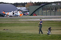 Systems operator Håvard Bakke enjoying a game of golf. Crew from Norwegian Air Force 330 squadron, flying Westland Sea King helicopter. The core mission of the squadron is SAR (search and rescue), but they also fly HEMS (Helicopter Emergency Medical Service), complementing the civilian air ambulance service.<br />