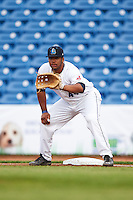 Lake County Captains first baseman Bobby Bradley (44) holds a runner on during a game against the Fort Wayne TinCaps on May 20, 2015 at Classic Park in Eastlake, Ohio.  Lake County defeated Fort Wayne 4-3.  (Mike Janes/Four Seam Images)