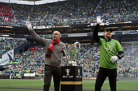 SEATTLE, WA - NOVEMBER 10: Seattle Sounders FC legend Chad Marshall and Toronto FC legend Danny Dichio place the Philip F. Anschutz Trophy onto a pedestal during a game between Toronto FC and Seattle Sounders FC at CenturyLink Field on November 10, 2019 in Seattle, Washington.