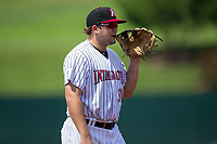 Kannapolis Intimidators third baseman Jake Burger (31) chews on the lace of his glove while on defense against the Hagerstown Suns at Kannapolis Intimidators Stadium on July 9, 2017 in Kannapolis, North Carolina.  The Intimidators defeated the Suns 3-2 in game one of a double-header.  (Brian Westerholt/Four Seam Images)