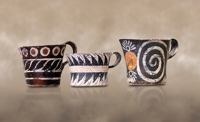 "Minoan Kamares ""eggshell"" ware cups with  with  polychrome decorations, from set found at Phaistos Palace 1800-1600 BC; Heraklion Archaeological  Museum.<br /> <br /> These cups found as parts of sets in Phaistos palace were names ""eggshell"" ware due to the very thin walls of the cups. This style of pottery is named afetr Kamares cave where this style of pottery was first found"