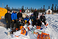 The *Cripple Crew* of volunteers pose for a photo outside of their tent *town* during the 2010 Iditarod race, Interior Alaska