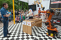 Moscow, Russia, 19/05/2012..A judge looks on as the German-built KUKA Monster chess robot plays Russia?s CHESSka robot for the title of Absolute World Robot Chess Champion. The Russian robot, developed by chess coach Konstantin Kosteniuk, comprehensively defeated its opponent, created by KUKA Robotics, one of the world?s largest manufacturers of industrial robots.