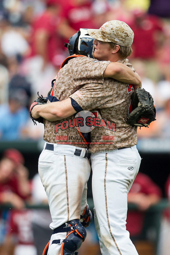 Virginia Cavaliers pitcher Josh Sborz (27) is hugged by catcher Matt Thaiss (21) after recording a save against the Arkansas Razorbacks in Game 1 of the NCAA College World Series on June 13, 2015 at TD Ameritrade Park in Omaha, Nebraska. Virginia defeated Arkansas 5-3. (Andrew Woolley/Four Seam Images)
