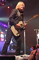 LIVERPOOL, UNITED KINGDOM - DECEMBER 06: Status Quo performs on stage during Quo Fest at Echo Arena on December 6, 2011 in Liverpool, United Kingdom<br /> <br /> <br /> People:  Rick Parfitt