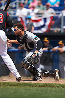 West Virginia Black Bears catcher Yoel Gonzalez (52) keeps his eye on the runner after blocking a pitch in the dirt during a game against the Batavia Muckdogs on June 25, 2017 at Dwyer Stadium in Batavia, New York.  West Virginia defeated Batavia 6-4 in the completion of the game started on June 24th.  (Mike Janes/Four Seam Images)