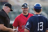 Kannapolis Intimidators manager Cole Armstrong (33) meets with Asheville Tourists manager Warren Schaeffer (13) and home plate umpire Chris Padgett prior to the start of the South Atlantic League game at Kannapolis Intimidators Stadium on May 26, 2016 in Kannapolis, North Carolina.  The Tourists defeated the Intimidators 9-6 in 11 innings.  (Brian Westerholt/Four Seam Images)