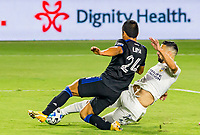CARSON, CA - OCTOBER 14: Nick Lima #24 of the San Jose Earthquakes and Sebastian Lletget #17 of the Los Angeles Galaxy chase down a loose ball during a game between San Jose Earthquakes and Los Angeles Galaxy at Dignity Heath Sports Park on October 14, 2020 in Carson, California.