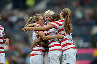 Glasgow, Scotland - Saturday, July 28, 2012: Carli Lloyd of the USA Women's soccer team celebrates with Megan Rapinoe, center, and Heather Mitts, left, after scoring a goal during a 3-0 win over Colombia in the first round of the Olympic football tournament at Hamden Park.