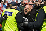© Joel Goodman - 07973 332324 - all rights reserved . 03/06/2017 . Liverpool , UK . EDL supporters are held back by police as anti-fascists attempt to break through police lines separating the two sides . Hundreds of police manage a demonstration by the far-right street protest movement , the English Defence League ( EDL ) and an demonstration by opposing anti-fascists , including Unite Against Fascism ( UAF ) . Photo credit : Joel Goodman