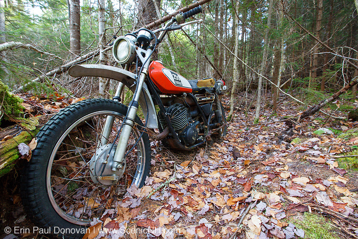 Abandoned Yamaha 250 motorcycle near the Mt Cilley Trail in Woodstock, New Hampshire.