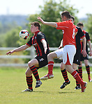 Conor Deasy of Bridge United A in action against David Mc Carthy of Newmarket Celtic A during their Clare Cup Final at Frank Healy Park. Photograph by John Kelly.
