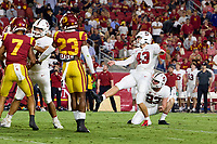 LOS ANGELES, CA - SEPTEMBER 11: Joshua Karty #43 of the Stanford Cardinal kicks a point after try during a game between University of Southern California and Stanford Football at Los Angeles Memorial Coliseum on September 11, 2021 in Los Angeles, California.