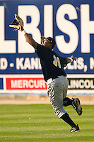 Charleston right fielder Jose Tabata (#39) chases down a fly ball during batting practice at Fieldcrest Cannon Stadium in Kannapolis, NC, Friday, April 28, 2006.