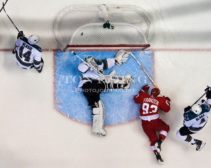 6 May 2010: Detroit Red Wings center Johan Franzen (93) beats San Jose Sharks goalie Evgeni Nabokov (20) to score, in the first period of Game 4 of the NHL Western Conference Semifinals series with the San Jose Sharks at the Detroit Red Wings, at Joe Louis Arena, in Detroit, MI...***** Editorial Use Only *****
