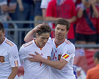 Spain forward Fernando Torres (9) celebrates his goal with teammates. In a friendly match, Spain defeated USA, 4-0, at Gillette Stadium on June 4, 2011.