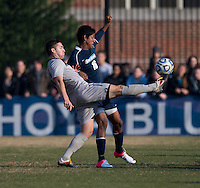 Tyler Rudy (13) of Georgetown clears the ball away from Dan Delgado (16) of San Diego during the game at North Kehoe Field in Washington, DC.  Georgetown defeated San Diego, 3-1.