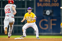 LSU Tigers shortstop Alex Bregman (8) waits for a throw as Nebraska base runner Blake Headly (22) runs to second base during the Houston College Classic on March 8, 2015 at Minute Maid Park in Houston, Texas. LSU defeated Nebraska 4-2. (Andrew Woolley/Four Seam Images)