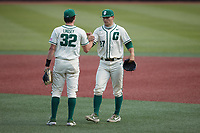 Charlotte 49ers starting pitcher Andrew Lindsey (32) shakes hands with relief pitcher Christian Lothes (27) as he enters the game against the Old Dominion Monarchs at Hayes Stadium on April 25, 2021 in Charlotte, North Carolina. (Brian Westerholt/Four Seam Images)