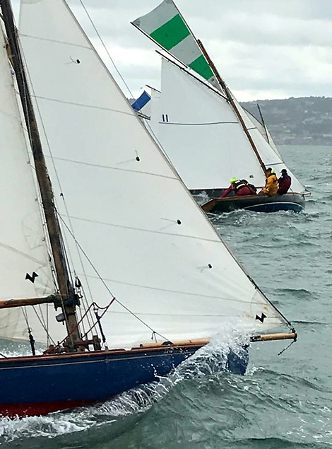 When it was still all systems go – Rosemary (foreground) retired with a broken gaff, but once Deilginis (11) had discarded her topsail as the wind freshened - not as easy as it looks – she took the last race and the title in convincing style. Photo: John Doran
