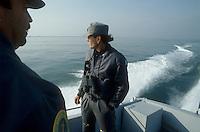 - patrol of Financial police against unauthorized fishermen of clams in the  Scardovari Lagoon (Po river delta)....- pattuglia della Guardia di Finanza contro i pescatori abusivi di vongole  nella Sacca di Scardovari (delta fiume Po)
