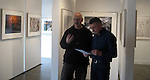 Dan Steinhardt (L) and the talent (R) reviewing talking points for Epson video at the Art Wolfe Gallery.