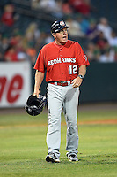 Oklahoma City RedHawks interim manager Tom Lawless (12) yells to the umpire after a call during a game against the Memphis Redbirds on May 23, 2014 at AutoZone Park in Memphis, Tennessee.  Oklahoma City defeated Memphis 12-10.  (Mike Janes/Four Seam Images)