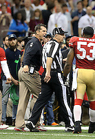 Feb 3, 2013; New Orleans, LA, USA; San Francisco 49ers head coach Jim Harbaugh argues with NFL side judge Joe Larrew in the closing seconds of the game against the Baltimore Ravens in Super Bowl XLVII at the Mercedes-Benz Superdome. Mandatory Credit: Mark J. Rebilas-